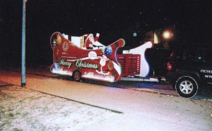Santa waves from his sleigh